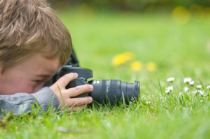 kid-with-camera-taking-pictures-lawn